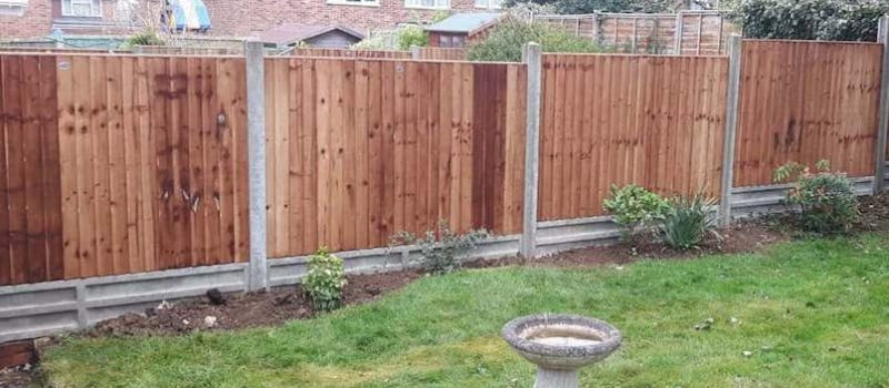 simple wood and concrete garden fence